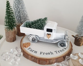White Christmas tree delivery truck with Snowy Farm fresh trees log slice plinth  plinth .. ready to dispatch