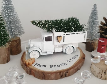 White Christmas tree delivery truck with Snowy Farm fresh trees log slice plinth .. ready to dispatch