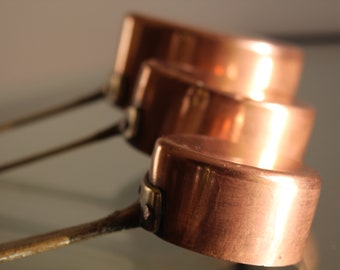 Set of three small copper pans, for decoration