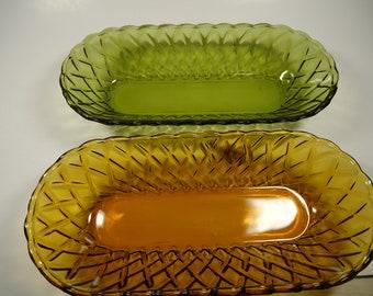 2 glass oblong bowls 1 green & 1 amber.