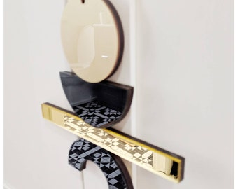 Geometric gold and black wall hanging