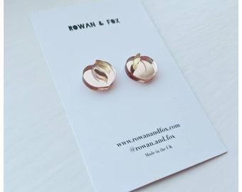 Peach statement earrings
