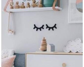 Wink eyes wall decoration
