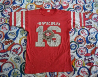 56541bcf5 Vintage 80's San Francisco 49ers Joe Montana NFL Jersey Ringer Champion  Brand T Shirt Size M