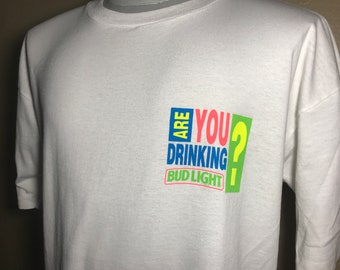 c23b756b454 Vintage 90's Are you drinking Bud Light Beer Budweiser Promo T-Shirt Size XL