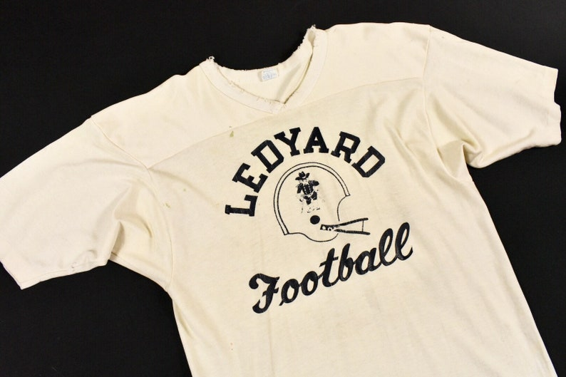 hot sale online 47e49 35431 70s Champion Large Ledyard Football Jersey Off White Short Sleeve Men's  Vintage Made In USA Blue Bar Tag