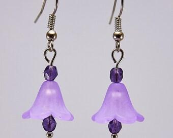 Drop flower earrings in purple with silver tone findings.