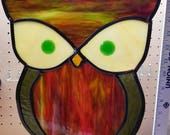 Owl - Stained glass sun catcher. Measures 10 in 12 in and includes 24 inches of black chain to hang.