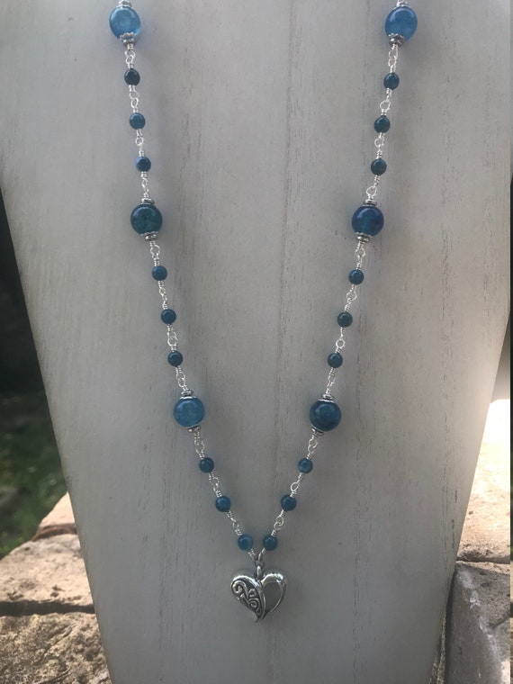Frog bead necklace with handblown glass ceramic and wood beads on  blue gray blue suede leather cord with a heart lobster claw clasp.
