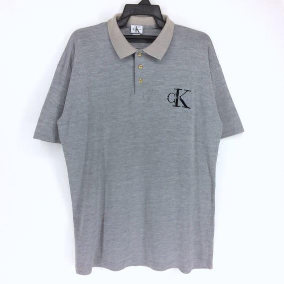 Vintage Calvin Klein Spell Out Logo Polo Calvin Klein Nice  48272887b3d