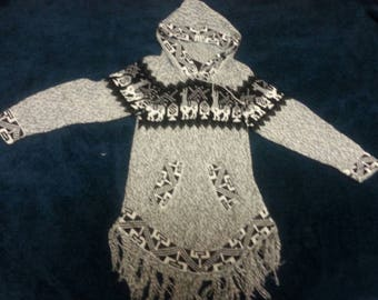 Beautiful and warm kids size alpaca sweater with hip contour shape and tassels