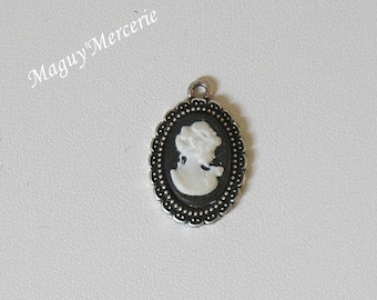 Silver cabochon grown old, and resin cameo Locket pendant
