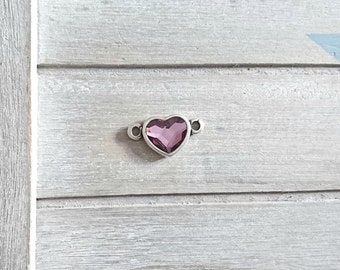 Swarovski pink heart connector. Zamak plated.Measures 15x26mm.