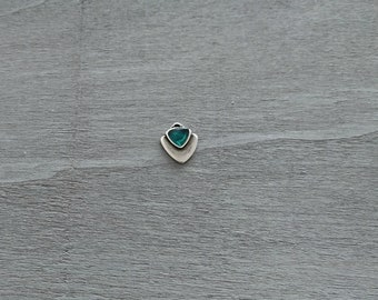 1 Triangle pendant with green resin. Measures 15x14mm.