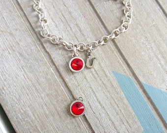 1 Round pendant with red swarovski. High quality silver zamak metal. 14x11mm