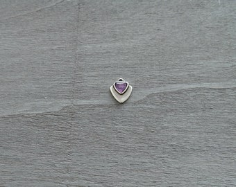 1 Triangle pendant with lilac resin. Measures 15x14mm.
