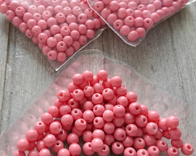 Opaque crystal beads in coral color. 4mm ball