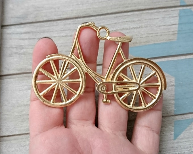 1 Bicycle XL Pendant. Measure 80x55mm. metal zamak high quality in golden color