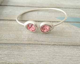Adjustable swarovski pink light bracelet.
