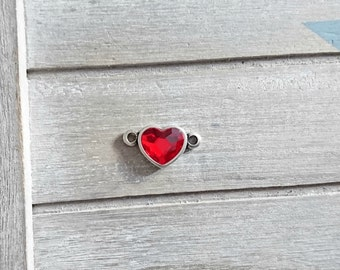 Swarovski red heart connector. Zamak plated.Measures 15x26mm.