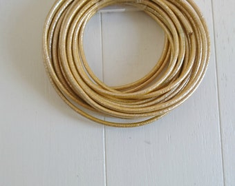Round gold metallic leather. of 2mm. leather for jewelry. leather European.