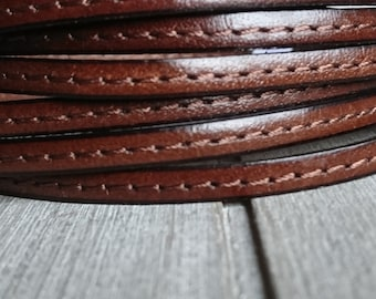 Brown leather stitched central. 5x2mm 1 meter. leather for bracelets. European leather of high quality.