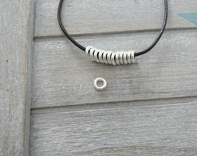 20 Small washers. Exterior of 8mm. 3.5 mm interior silver zamak