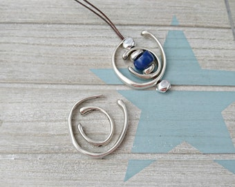 2 pendants Irregular semi circle pins in two sizes: large 40mm. and 27mm.
