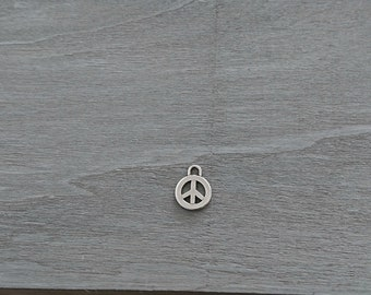 Pendant symbol of peace. 17mm. zamak plated