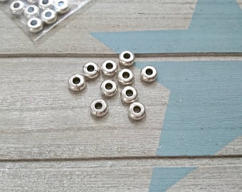 10 pieces. Rondel Zamak 7.5mm outer Interior pass 3mm. European leather sliders. sterling silver plated. Antique silver