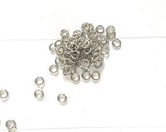 50 open rings. 5mm measurement silver-plated brass