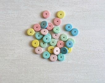 30 ceramic beads various colors. outside 8mm. int. 0.5mm