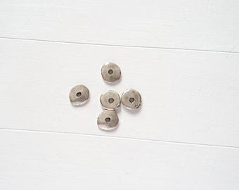 Irregular washer. 14X12mm. 5 units. zamak silver