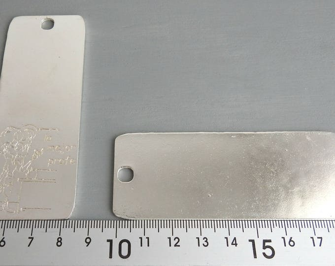 2 Irregular book point of 9 centimeters x 3.5 centimeters. pewter with silver plated.