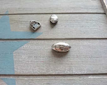1 Close rugby ball magnet. 10x2mm interior zamak with silver
