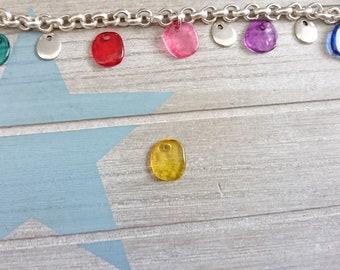 Irregular hanging trinket. yellow resin. 16mm 1 unit