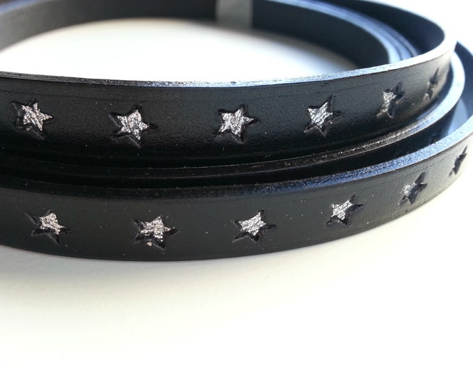 50cms. Black leather with silver stars. width 10mm.