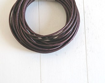 Round leather metallic garnet. of 2mm.