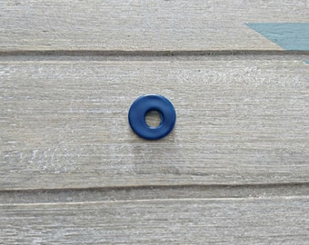 Dark blue washer. Zamak. Outside 15mm.