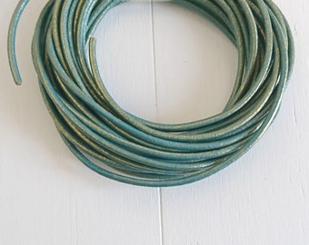 Gold metallic green round leather. of 2mm.