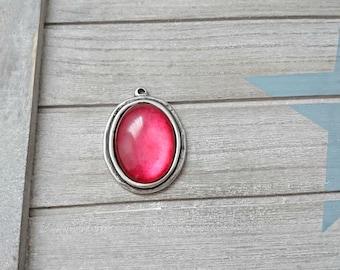 Oval pendant - 50x45mm. silver plated zamak - fuchsia resin