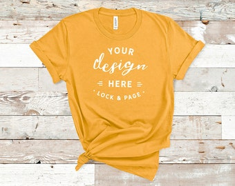 Download Free Gold Bella Canvas 3001 TShirt Mockup Plain Beach House Background Women's Knotted T-Shirt POD Shop Mock Up Flat Lay PSD Template
