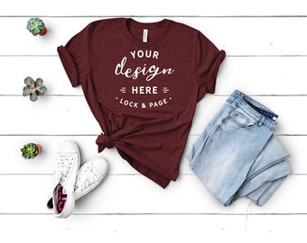 Download Free Bella Canvas 3001 Heather Cardinal Unisex TShirt Mockup Flat Lay Red Wine Color Burgundy Maroon Shirt Mock Up White Wood Backdrop PSD Template