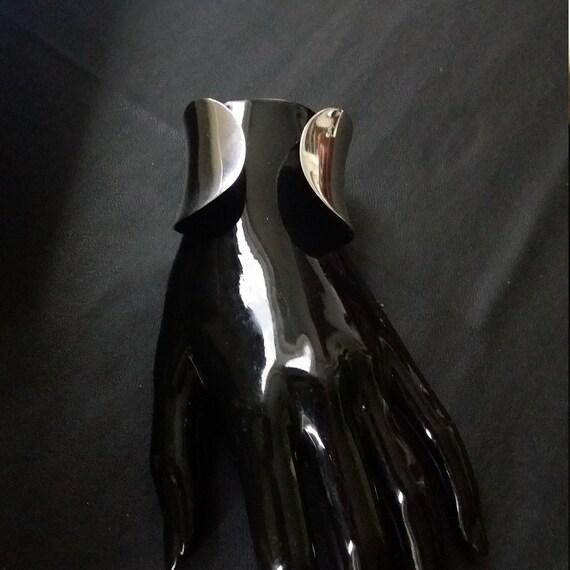 Broad silver bangle of Esprit