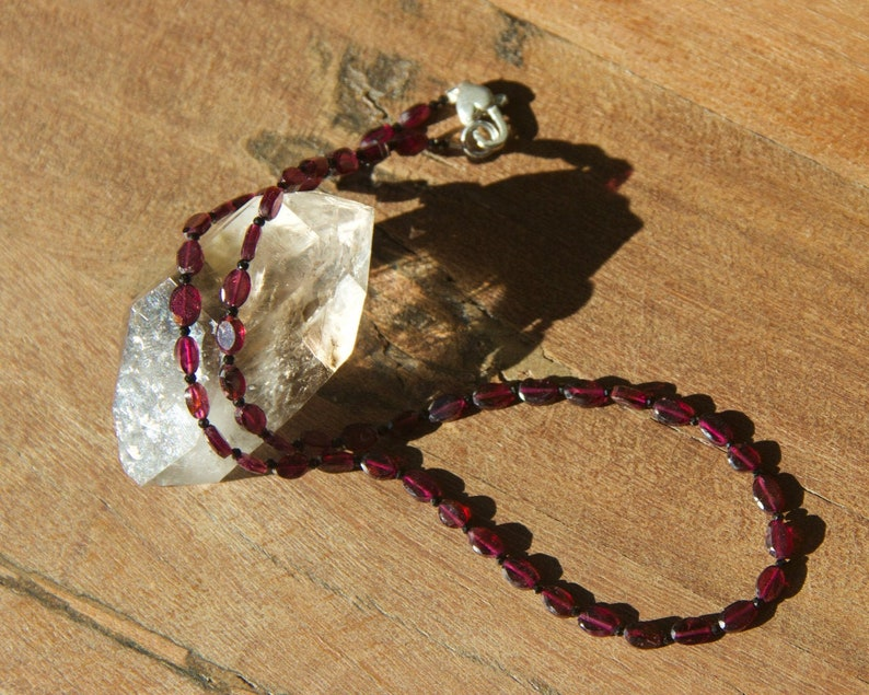 Grade AA Garnet choker with sterling heart clasp