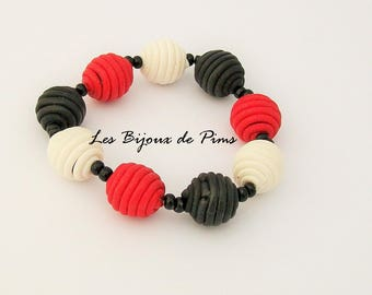 Black, red and white bracelet with polymer clay