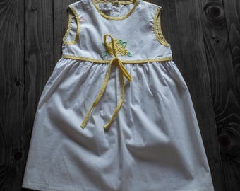 White dress with yellow knitted flowers