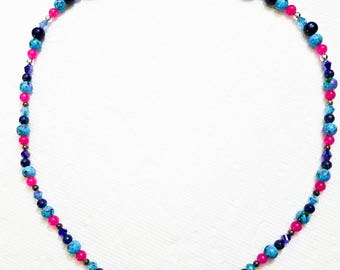 Turquoise necklace with pink and violet accents.