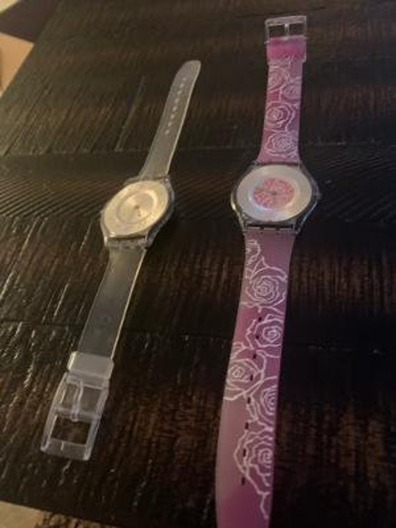 2 swatch watches pink and grey