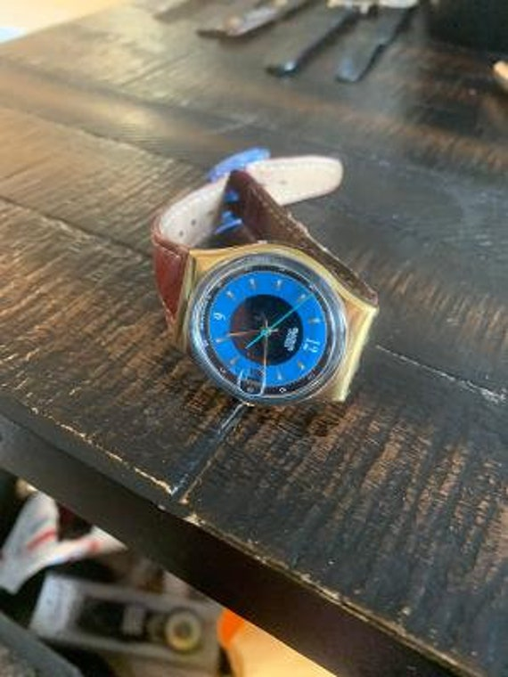 maroon band blue swatch watch